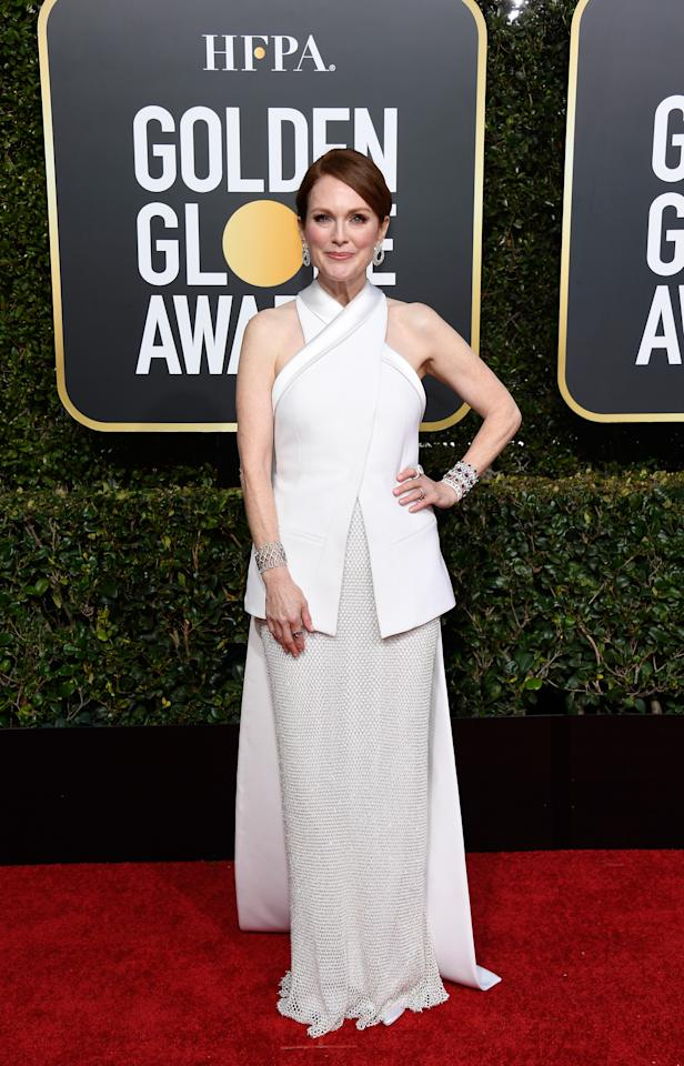 <p>Moore wore a fashion forward white ensemble by Givenchy.<br />Image via Getty Images. </p>