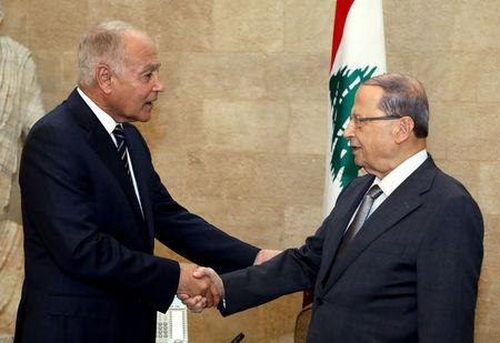 Lebanon's President Michel Aoun shakes hands with Arab League Secretary-General Ahmed Aboul Gheit at the presidential palace in Baabda