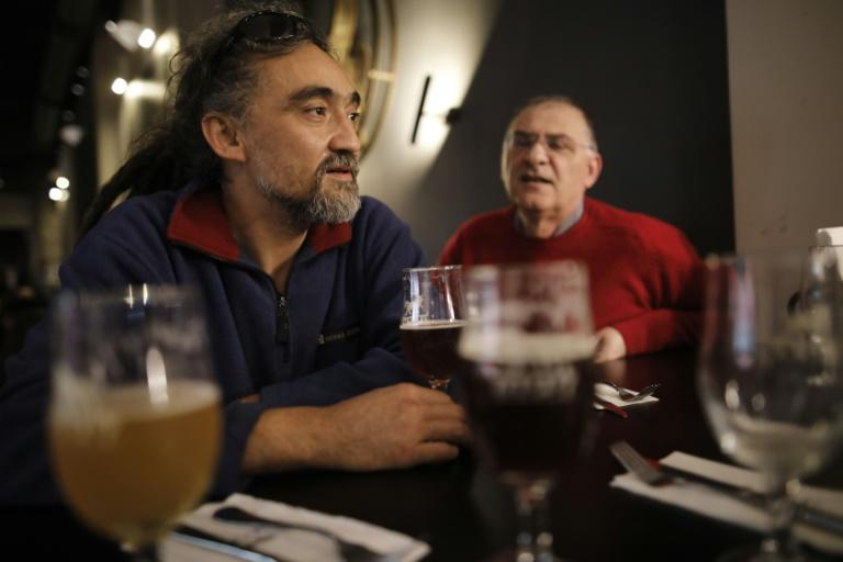 Arik Salarov (L) and Leonid Lipkin, the owners of the Libira Brewery pub, sit at their brewery in the northern Israeli city of Haifa