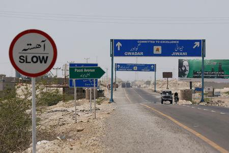 FILE PHOTO: A general view of signs along a highway leading to Gwadar, Pakistan April 12, 2017. Picture taken April 12, 2017. REUTERS/Akhtar Soomro