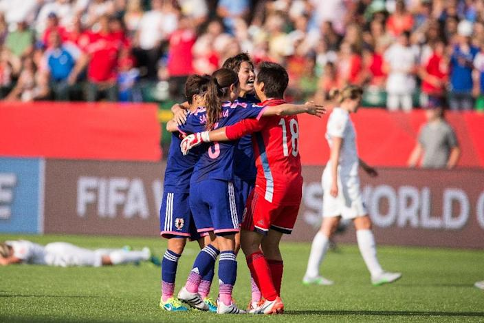Japan players celebrate victory over England in their FIFA Women's World Cup semi-final at Commonwealth Stadium in Edmonton, Canada, on July 1, 2015 (AFP Photo/Geoff Robins)