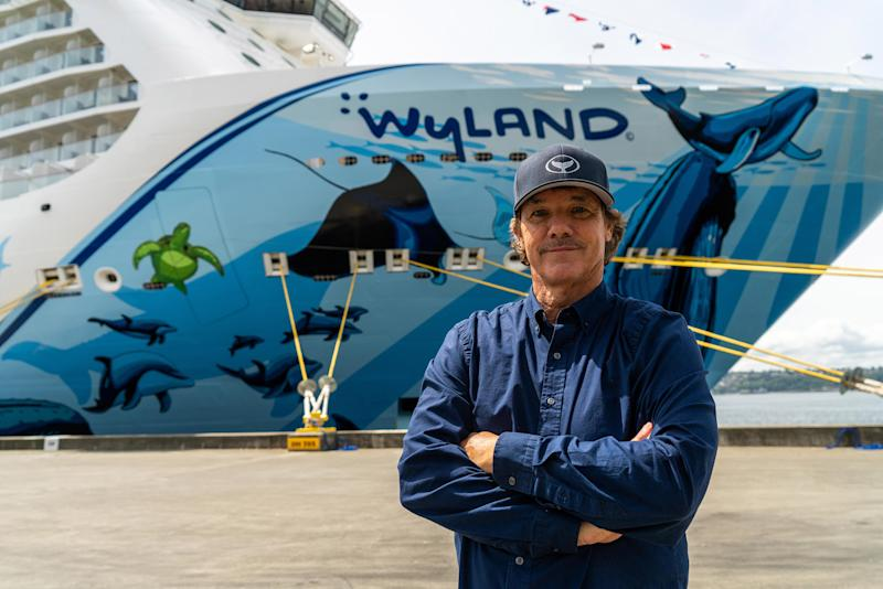 Renowned marine life artist and conservationist, Wyland, in front of his hull art on Norwegian Bliss