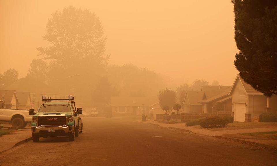 An orange smoke-filled sky is seen above Molalla, Oregon on Thursday as fires burn nearby.