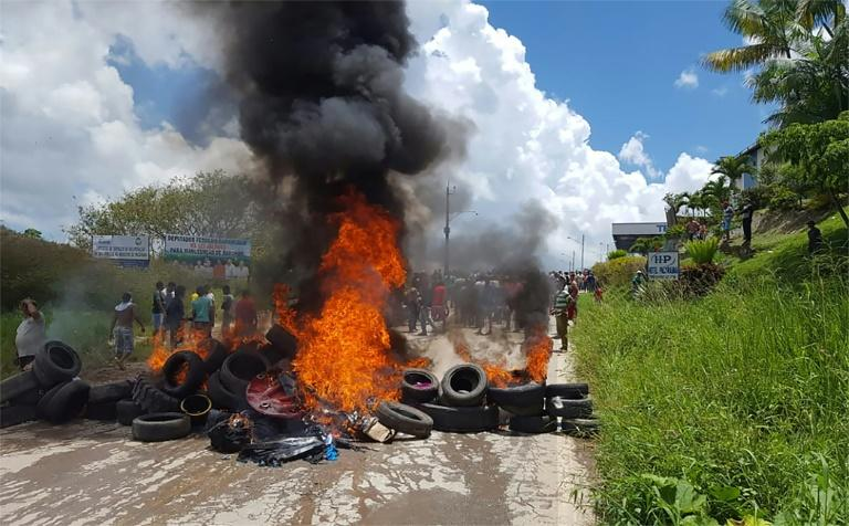 Residents of the Brazilian border town of Pacaraima burn tyres and belongings of Venezuelans immigrants after attacking their makeshift camps and forcing them back across the border on August 18, 2018