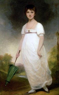 Woman in dress with green umbrella.