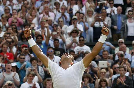 Rafael Nadal of Spain reacts after defeating Martin Klizan of Slovaki in their men's singles tennis match at the Wimbledon Tennis Championships, in London June 24, 2014. REUTERS/Suzanne Plunkett