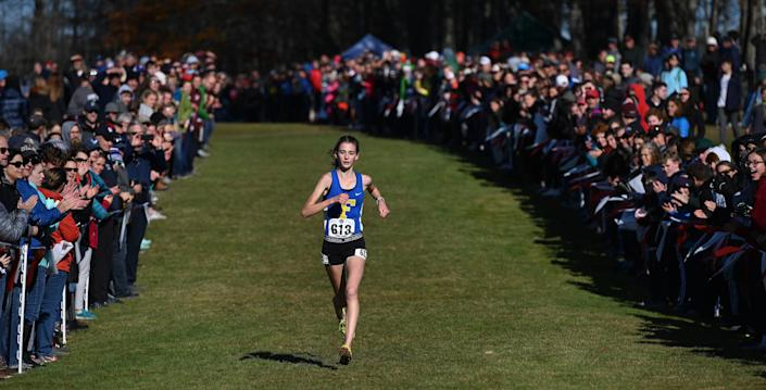 Falmouth's Sofie Matson leads the pack as she heads to the finish line of the Class A high school cross country championships at Twin Brook Saturday, Nov. 2, 2019.