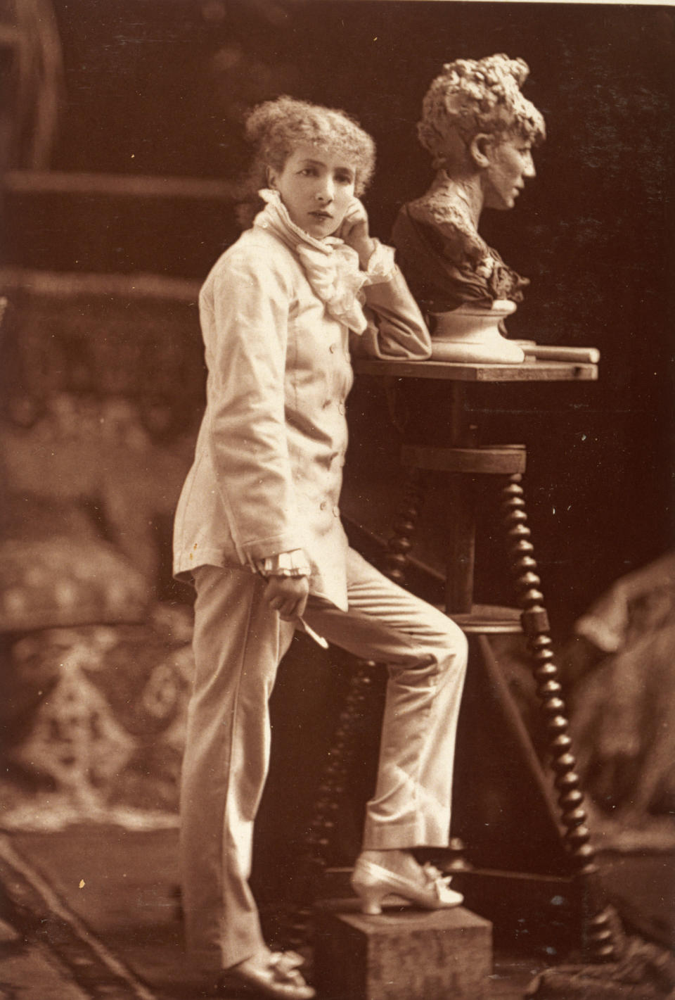 Actress Sarah Bernhardt wearing a trouser suit as she sculpts a self-portrait, in a photo from the late 19th century. (Photo: Museum of London/Heritage Images/Getty Images)
