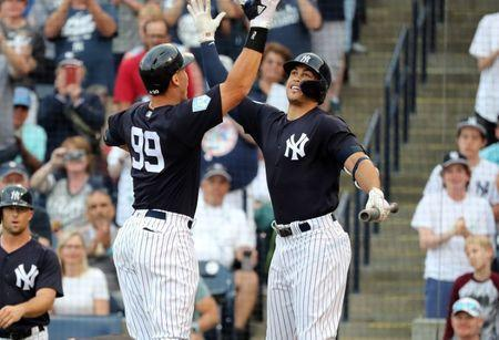 Mar 12, 2019; Tampa, FL, USA; New York Yankees right fielder Aaron Judge (99) is congratulated by left fielder Giancarlo Stanton (27) after Judge hit a two run home run during the first inning against the Baltimore Orioles at George M. Steinbrenner Field. Mandatory Credit: Kim Klement-USA TODAY Sports