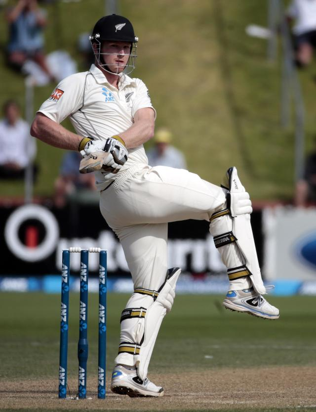 New Zealand's James Neesham misses a shot against India during the second innings on day four of the second international test cricket match at the Basin Reserve in Wellington, February 17, 2014. REUTERS/Anthony Phelps (NEW ZEALAND - Tags: SPORT CRICKET)