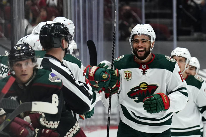 Minnesota Wild left wing Jordan Greenway (18) celebrates after scoring a goal against the Arizona Coyotes during the second period of an NHL hockey game Friday, March 5, 2021, in Glendale, Ariz. (AP Photo/Rick Scuteri)