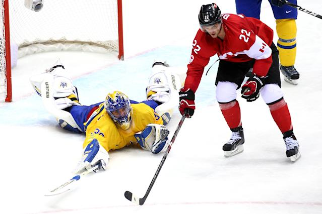 SOCHI, RUSSIA - FEBRUARY 23: Henrik Lundqvist #30 of Sweden makes a save against Jamie Benn #22 of Canada during the Men's Ice Hockey Gold Medal match on Day 16 of the 2014 Sochi Winter Olympics at Bolshoy Ice Dome on February 23, 2014 in Sochi, Russia. (Photo by Streeter Lecka/Getty Images)