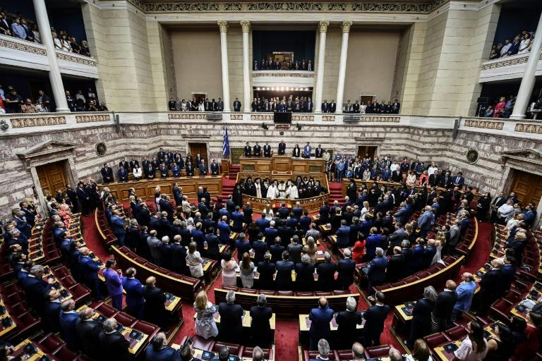 Greek lawmakers were sworn in Wednesday and will elect a speaker Thursday (AFP Photo/Aris MESSINIS)
