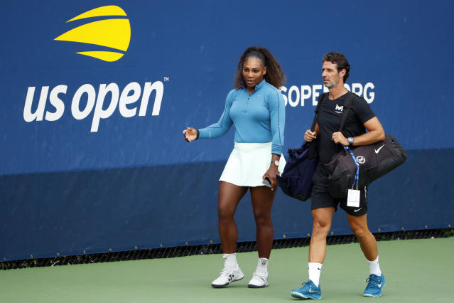 FILE - In this Aug. 31, 2018, file photo, Serena Williams walks on a practice court with her coach Patrick Mouratoglou during the third round of the U.S. Open tennis tournament in New York. The tenor of the final between Williams and champion Naomi Osaka, whose terrific performance was largely ignored amid the chaos that enveloped Arthur Ashe Stadium, began to shift after chair umpire Carlos Ramos warned Williams for receiving coaching signals. (AP Photo/Adam Hunger, File)