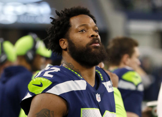 FILE - In this Dec. 24, 2017, file photo, Seattle Seahawks defensive end Michael Bennett (72) watches his team play the Dallas Cowboys during an NFL football game in Arlington, Texas. A Harris County, Texas, grand jury on Friday, March 23, 20187, indicted Philadelphia Eagles defensive end Michael Bennett on a felony count of injury to the elderly for injuring a 66-year-old paraplegic who was working at NRG Stadium in Houston to control access to the field at Super Bowl 51, prosecutors said. The Eagles earlier this month acquired Bennett from the Seahawks. (AP Photo/Michael Ainsworth, File)