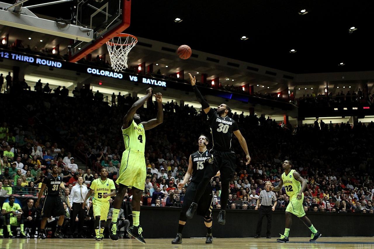 ALBUQUERQUE, NM - MARCH 17:  Carlon Brown #30 of the Colorado Buffaloes shoots against Quincy Acy #4 of the Baylor Bears in the first half during the third round of the 2012 NCAA Men's Basketball Tournament at The Pit on March 17, 2012 in Albuquerque, New Mexico.  (Photo by Christian Petersen/Getty Images)