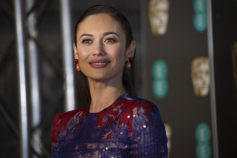 Olga Kurylenko poses for photographers upon arrival at the BAFTA Film Awards in London, Sunday, Feb. 10, 2019. (Photo by Vianney Le Caer/Invision/AP)