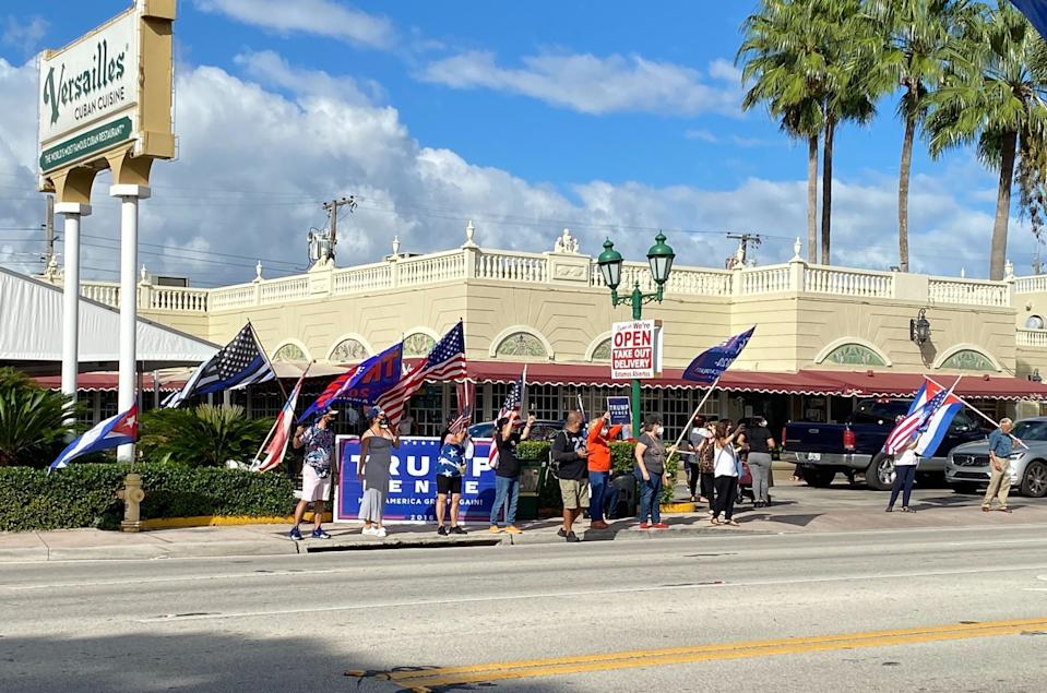 A group of Trump supporters protests against a Biden caravan on Oct. 18, in Miami.