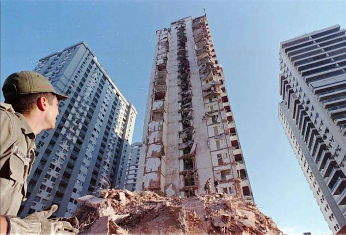 A firefighter from Rio De Janeiro, Brazil looks at the partially collapsed, 22-story Palace II before what was left of it was imploded. The apartment tower collapsed Feb. 22, 1988, killing eight people and leaving 120 families homeless.