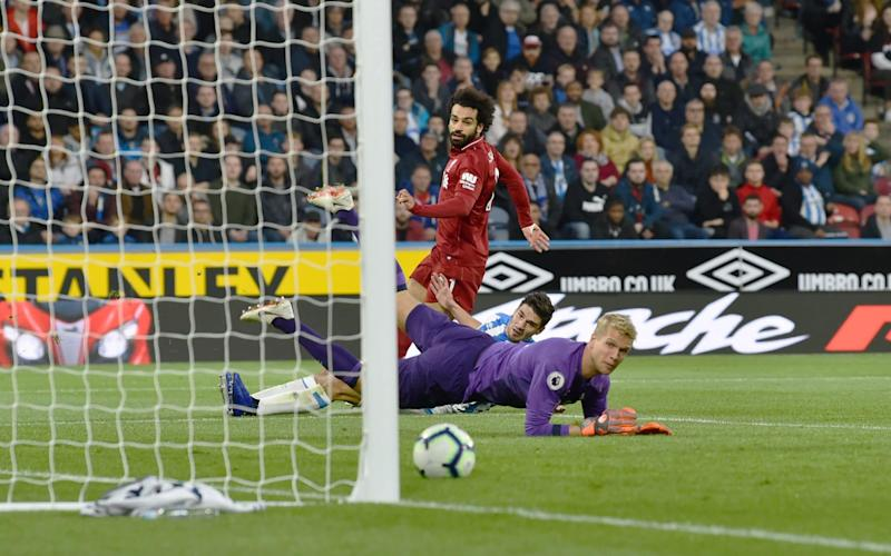Mohamed Salah strokes the ball into the net - Liverpool FC