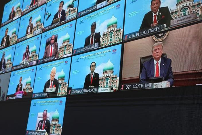 U.S. President Donald Trump is seen on a screen attending the virtual APEC Economic Leaders Meeting 2020, in Kuala Lumpur