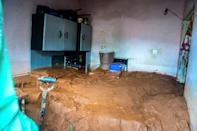 Aftermath: Mud fills a home in Chimanimani