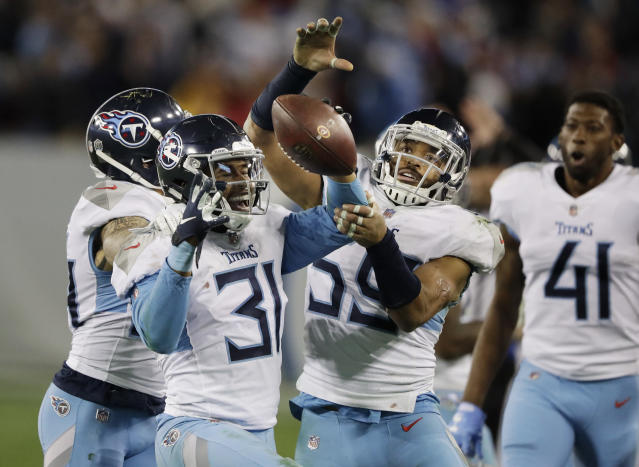 Tennessee Titans free safety Kevin Byard (31) celebrates after intercepting a pass against the Washington Redskins late in the fourth quarter of an NFL football game Saturday, Dec. 22, 2018, in Nashville, Tenn. (AP Photo/James Kenney)