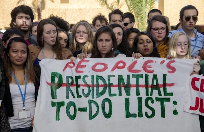 American students protest outside the UN climate talks in Marrakesh in reaction to Donald Trump's victory in the US presidential election (AFP Photo/Fadel Senna)