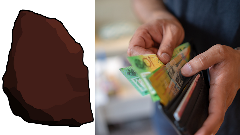 The cartoon rock which sold for $1.8 million and someone removing money from a wallet.