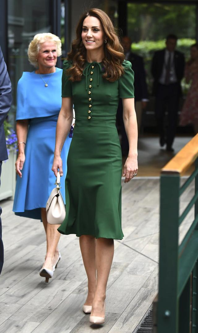 """Kate Middleton <a href=""""https://people.com/royals/kate-middleton-rewears-green-dress-wimbledon/"""" rel=""""nofollow noopener"""" target=""""_blank"""" data-ylk=""""slk:attended the Women's Single Finals Wimbledon"""" class=""""link rapid-noclick-resp"""">attended the Women's Single Finals Wimbledon</a> with Pippa Middleton and Meghan Markle wearing a green Dolce & Gabbana midi dress with button detail (a royal re-wear!), nude pumps and a matching nude top-handle bag. <strong>Get the Look!</strong> All In Favor Double Breasted Midi Dress, $35.40 (orig. $59); <a href=""""https://click.linksynergy.com/deeplink?id=93xLBvPhAeE&mid=1237&murl=https%3A%2F%2Fshop.nordstrom.com%2Fs%2Fall-in-favor-double-breasted-midi-dress%2F5267143&u1=PEO%2CShopping%3AEverythingYouNeedtoCopyKateMiddleton%E2%80%99sSummerStyle%2Ckamiphillips2%2CUnc%2CGal%2C7115494%2C201908%2CI"""" rel=""""nofollow noopener"""" target=""""_blank"""" data-ylk=""""slk:nordstrom.com"""" class=""""link rapid-noclick-resp"""">nordstrom.com</a> Privacy Please Leandra Midi Dress, $188; <a href=""""http://www.anrdoezrs.net/links/8029122/type/dlg/sid/PEO,Shopping:EverythingYouNeedtoCopyKateMiddleton'sSummerStyle,kamiphillips2,Unc,Gal,7115494,201908,I/https://www.revolve.com/privacy-please-leandra-midi-dress/dp/PRIP-WD811/"""" rel=""""nofollow noopener"""" target=""""_blank"""" data-ylk=""""slk:revolve.com"""" class=""""link rapid-noclick-resp"""">revolve.com</a> Whistles Microspot Midi Dress, $339; <a href=""""https://click.linksynergy.com/deeplink?id=93xLBvPhAeE&mid=1237&murl=https%3A%2F%2Fshop.nordstrom.com%2Fs%2Fwhistles-microspot-midi-dress%2F5337753&u1=PEO%2CShopping%3AEverythingYouNeedtoCopyKateMiddleton%E2%80%99sSummerStyle%2Ckamiphillips2%2CUnc%2CGal%2C7115494%2C201908%2CI"""" rel=""""nofollow noopener"""" target=""""_blank"""" data-ylk=""""slk:nordstrom.com"""" class=""""link rapid-noclick-resp"""">nordstrom.com</a> Urban CoCo Short Sleeve Waisted Slim Fit Midi Dress, $18.98; <a href=""""https://www.amazon.com/Urban-CoCo-Womens-Sleeve-Waisted/dp/B07S1FFJZG/ref=as_li_ss_tl?keywords=green+midi+dress+women&qid=1563380417&s=gateway"""