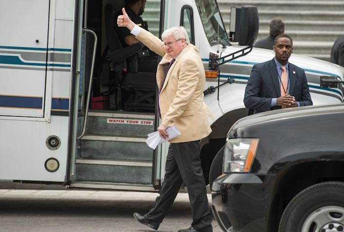 Rep. Glenn Grothman (R-Wis.) gives a thumbs-up to protesters on the East Front of the Capitol after the House passed the Republicans' bill to repeal and replace the Affordable Care Act on May 4, 2017. The protesters support the ACA.