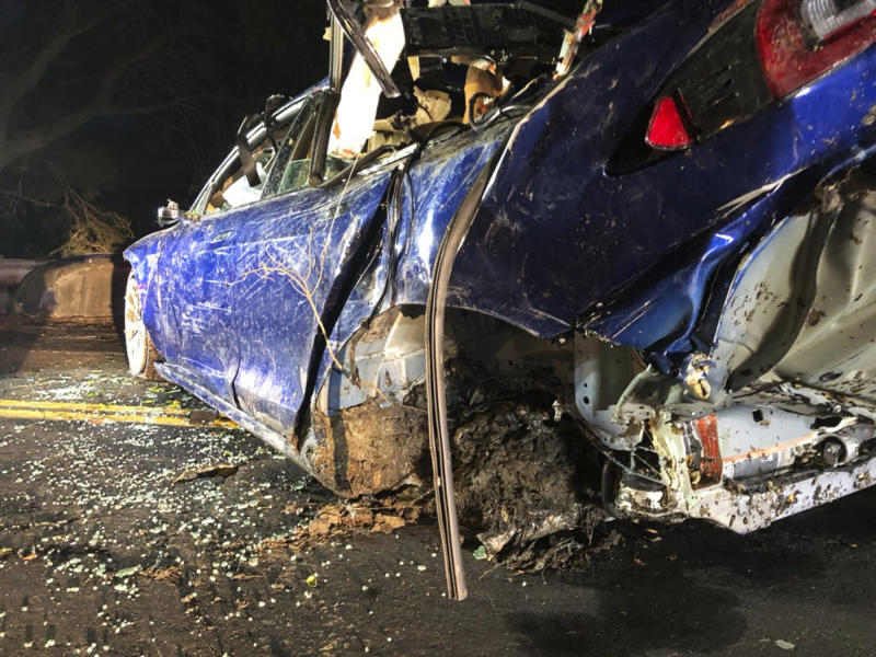 This photo provided by NBC Bay Area-KNTV shows a Tesla car after it was pulled from a pond near the city of San Ramon, Calif., on Monday, May 21, 2018. Authorities in the San Francisco Bay Area are investigating the death of a man after the Tesla car he was driving veered off a road, crashed through a fence and into a pond. (Bob Rendell/NBC Bay Area/KNTV via AP)
