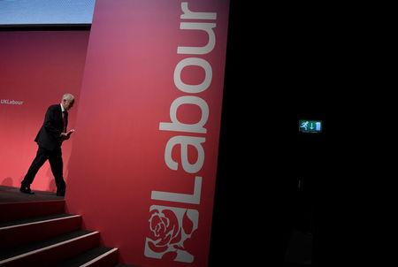 Britain's opposition Labour party leader Jeremy Corbyn leaves the stage during the Labour party Conference in Brighton, Britain, September 24, 2017. REUTERS/Toby Melville