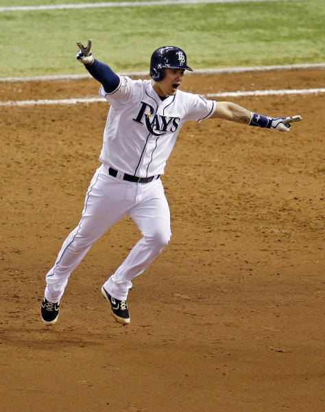Tampa Bay Rays' Jose Lobaton celebrates a ninth inning home run against the Boston Red Sox to win Game 3 of an American League baseball division series in St. Petersburg, Fla., Monday, Oct. 7, 2013. Tampa Bay Rays won the game 5-4. (AP Photo/John Raoux)