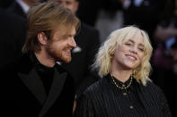 Finneas O'Connell, left, and Billie Eilish posesfor photographers upon arrival for the World premiere of the new film from the James Bond franchise 'No Time To Die', in London Tuesday, Sept. 28, 2021. (AP Photo/Matt Dunham)