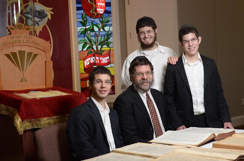 In this photo taken Wednesday, April 4, 2012 released by The Lori Schottenstein Chabad Center shows from left,  son, Mendy, Rabbi Areyah Kaltmann, and sons, Yitzi  and Shea, taken at The Lori Schottenstein Chabad Center in Columbus, Ohio.   Rabbi Areyah Kaltmann  bought  tractates, or passages that make up religious and civil law known as the Talmud, from an auction house. They are part of a limited number of books the U.S. Army authorized for publication. (AP Photo/HO, Lorn Spolter)