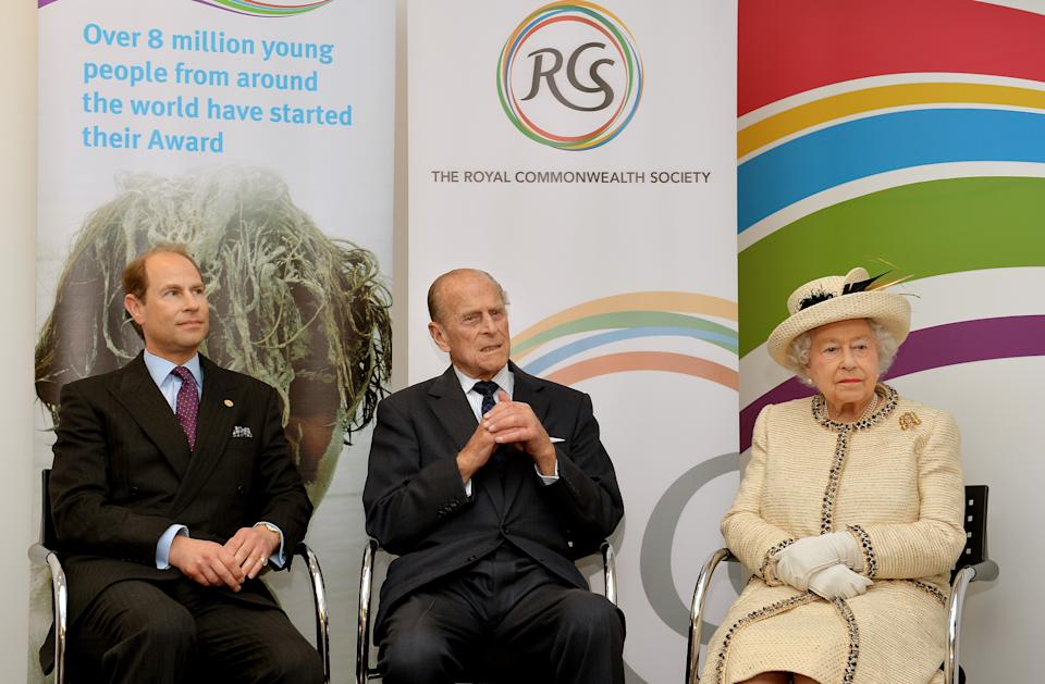 LONDON, ENGLAND - MARCH 12:  (L-R) Prince Edward, Earl of Wessex, Prince Philip, Duke of Edinburgh and Queen Elizabeth II listen to a welcome address at the start of their visit to the Royal Commonwealth Society in Westminster on March 12, 2014 in London, England.  (Photo by John Stillwell - WPA Pool/Getty Images)