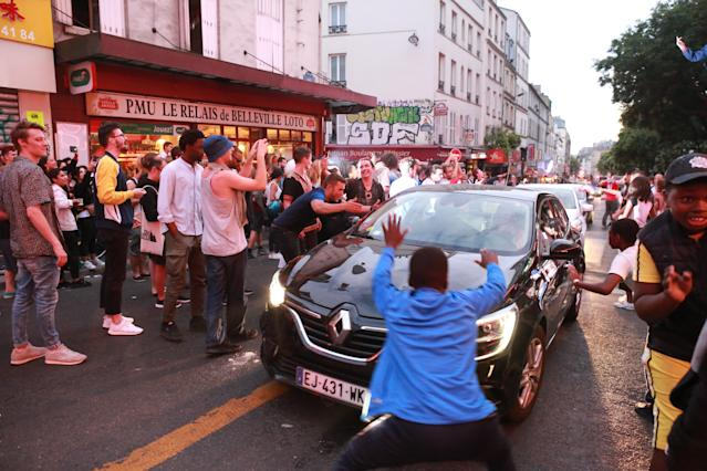 <p>French fans erupt with joy, outside a local bar in the 20th arrondissement, as France wins its semi-final World Cup match against Belgium, on July 10, 2018 in Paris, France. (Photo by Owen Franken – Corbis/Corbis via Getty Images) </p>