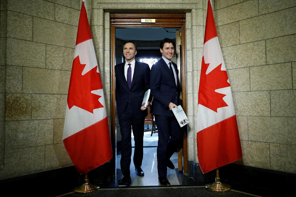 Canada's Prime Minister Justin Trudeau and Finance Minister Bill Morneau walk from Trudeau's office to the House of Commons to deliver the budget on Parliament Hill in Ottawa, Ontario, Canada, February 27, 2018. REUTERS/Chris Wattie