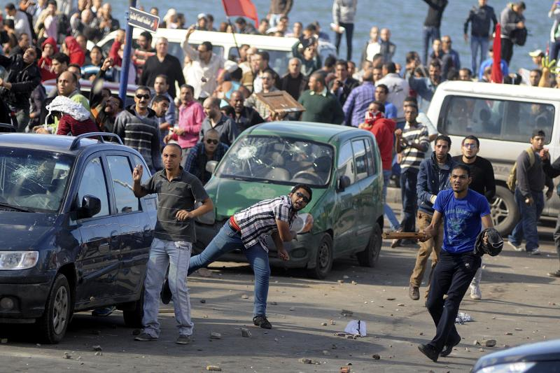 Protesters hurl stones during clashes between supporters and opponents of President Mohammed Morsi in Alexandria, Egypt, Friday, Nov. 23, 2012. Opponents and supporters of Mohammed Morsi clashed across Egypt on Friday, the day after the president granted himself sweeping new powers that critics fear can allow him to be a virtual dictator. Thousands from the two camps threw stones and chunks of marble at each other outside a mosque in the Mediterranean city of Alexandria after Friday Muslim prayers. (AP Photo/Tarek Fawzy)