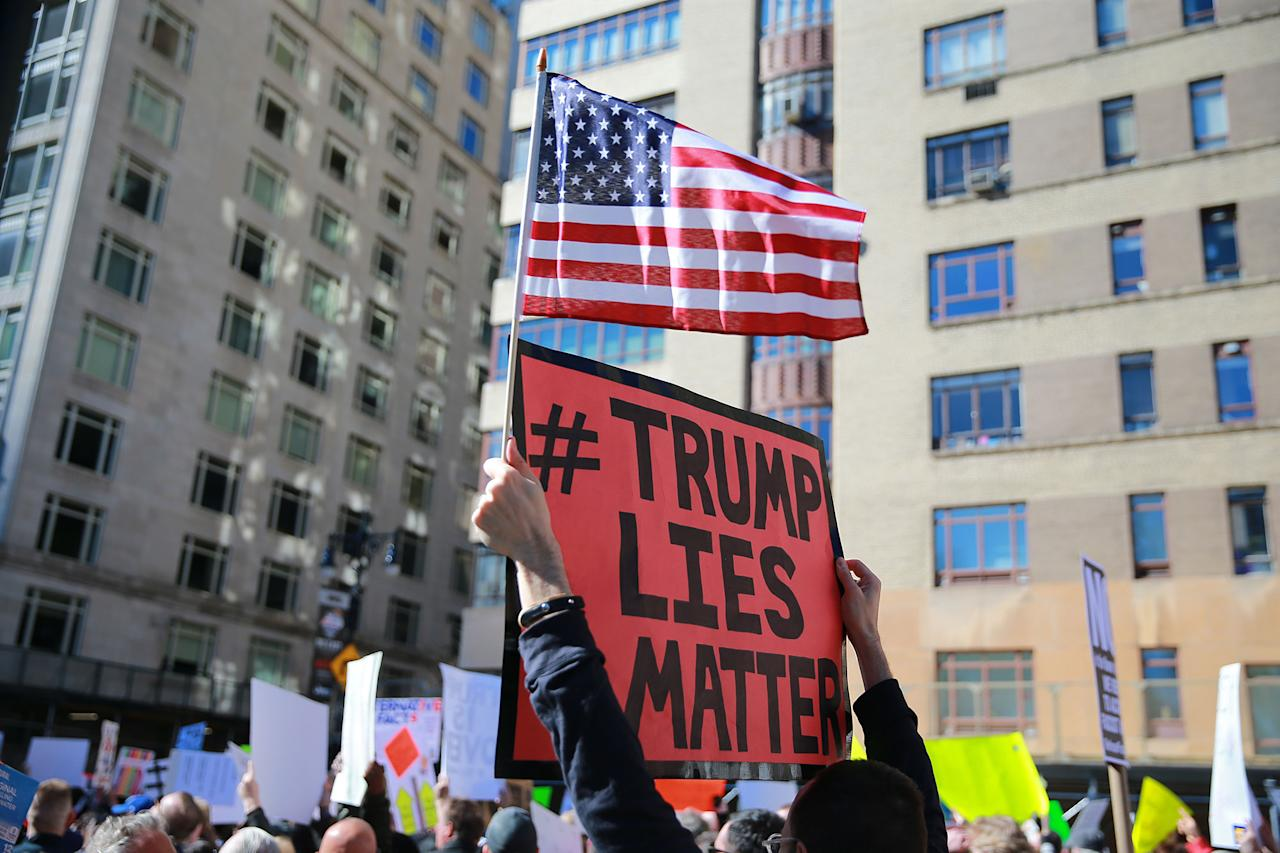 """<p>A demonstrator holds up a sign and U.S. flag during the """"Not My President's Day"""" rally at Central Park West in New York City on Feb. 20, 2017. (Gordon Donovan/Yahoo News) </p>"""