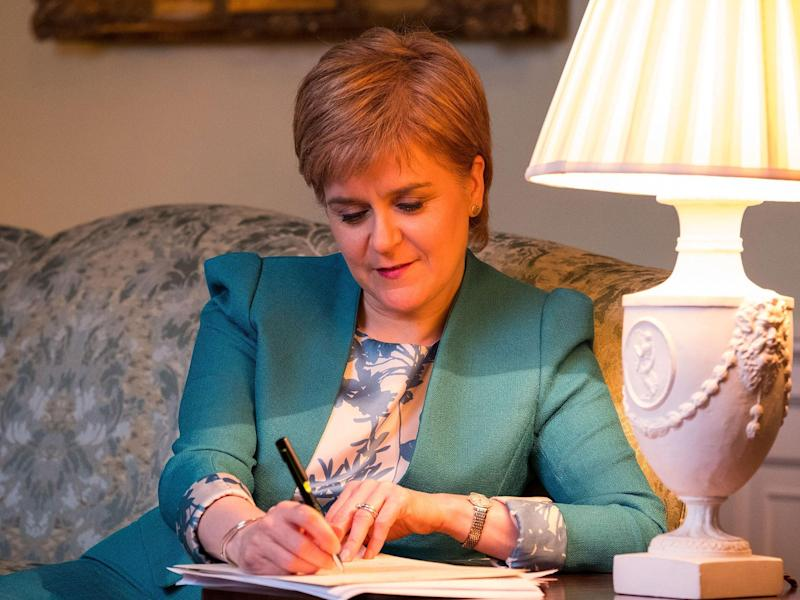 The Scottish Government tweeted a picture of the First Minister with her feet up on a couch in her Bute House residence writing the Section 30 letter: PA