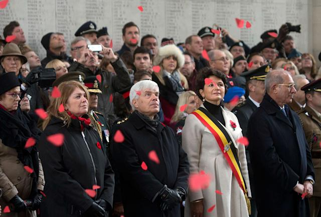 <p>Paper poppies fall from the ceiling of the Menin Gate during an Armistice Day ceremony in Ypres, Belgium on Saturday, Nov. 11, 2017. The Menin Gate Memorial bears the names of more than 54,000 British and Commonwealth soldiers who were killed in the Ypres Salient of World War I and whose graves are not known. (Photo: Virginia Mayo) </p>