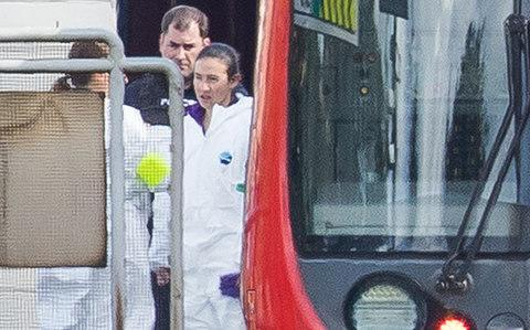Forensics officers can be seen next to the evacuated tube train - Credit: Peter Macdiarmid/LNP