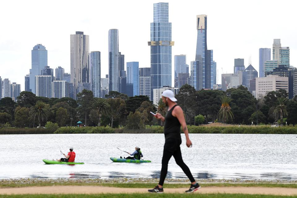 People are seen canoeing at Albert Park Lake in Melbourne, Thursday, October 7, 2021. Source: AAP