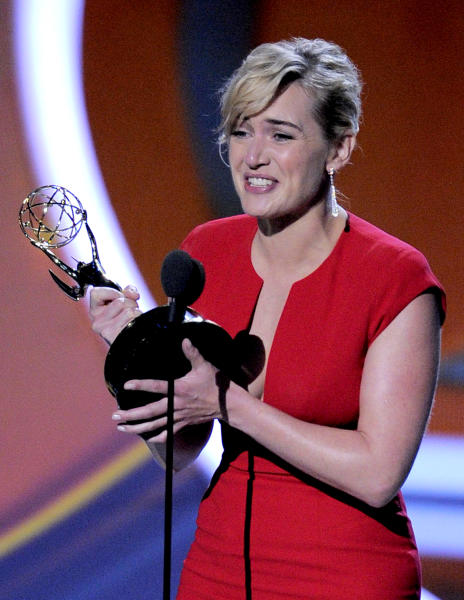 "FILE - In this Sept. 18, 2011 file photo, Kate Winslet accepts the award for outstanding lead actress in a mini-series or movie for ""Mildred Pierce"" at the 63rd Primetime Emmy Awards in Los Angeles. The Academy of Television Arts & Sciences said Thursday, May 31, 2012 that it will merge the leading and supporting acting categories for such longform programming. Starting with the 2013 awards, new categories for outstanding actor in a miniseries or TV movie and outstanding actress in a miniseries or movie will each include six nominees. Previously, the four movie and miniseries acting categories included five nominees. (AP Photo/Mark J. Terrill, file)"