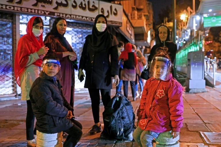An Iranian family seeks safety on the streets of Tehran after a 4.6 magnitude quake rocks a city already struggling with the Middle East's deadliest coronavirus outbreak