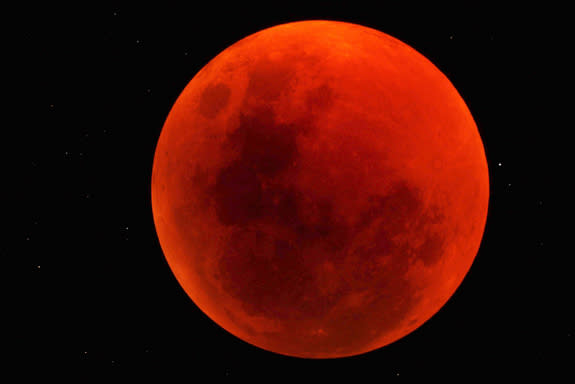 The moon turned a blood red over the Sossusvlei Desert Lodge on NamibRand Nature Reserve in Namibia in this stunning photo taken by skywatcher George Tucker on June 15, 2011.