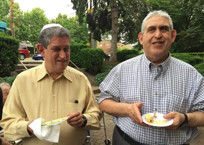 """<p>David Rosenthal, left, 54, and Cecil Rosenthal, 59, went through life together with help from a disability-services organization. An important part of the brothers' lives was the Tree of Life synagogue, where they never missed a Saturday service, people who knew them say. The developmentally disabled brothers lived independently together in an Achieva building. David had worked with Achieva's cleaning service and at Goodwill Industries, and Cecil was hoping to start working soon. While David was quieter, Cecil had a personality that got him dubbed """"the honorary mayor of Squirrel Hill."""" (Photo: browniebear via Twitter) </p>"""