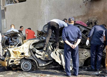 Egyptian security personnel and residents check the site of an explosion in Ismailia